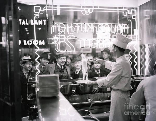 Pedestrian Art Print featuring the photograph Onlookers Watching Cook In Window by Bettmann