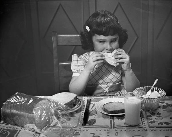 Milk Art Print featuring the photograph Portrait Of Little Girl Eating Buttered by George Marks