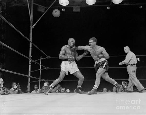 People Art Print featuring the photograph Rocky Marciano Boxing Joe Walcott by Bettmann
