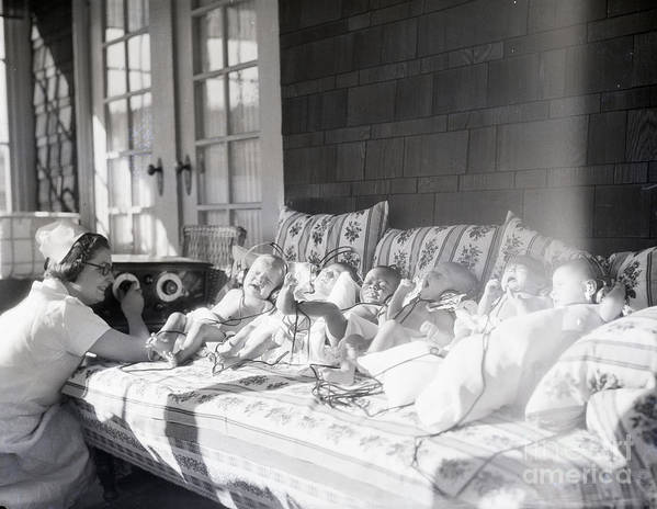 Medical Research Art Print featuring the photograph Trying To Calm Babies With Radio by Bettmann