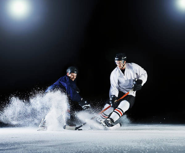 Young Men Art Print featuring the photograph Two Ice Hockey Players Challenging For by Robert Decelis Ltd