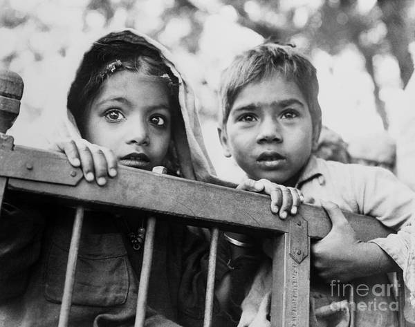 New Delhi Art Print featuring the photograph Two Young Indian Children Holding by Bettmann