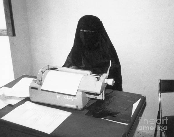 Working Art Print featuring the photograph Yemeni Woman Typing In Chador And Veil by Bettmann