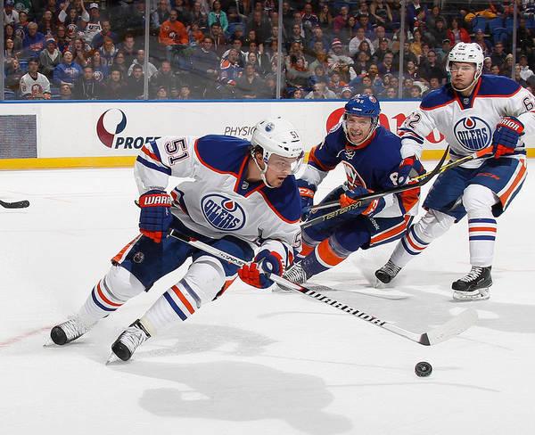 National Hockey League Art Print featuring the photograph Edmonton Oilers v New York Islanders by Bruce Bennett