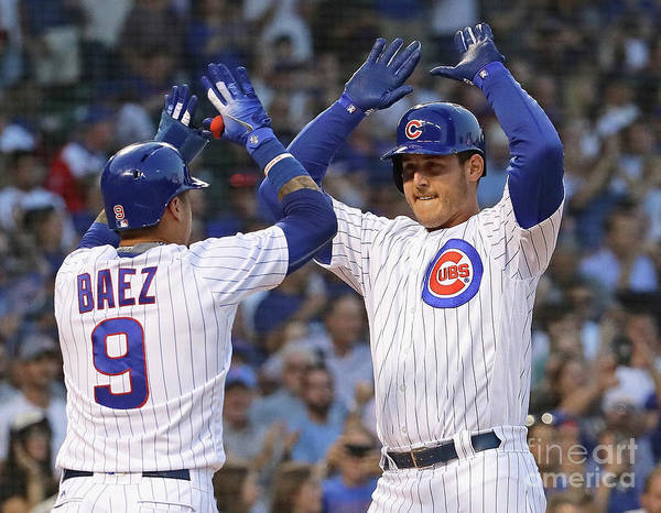 Three Quarter Length Art Print featuring the photograph Anthony Rizzo and Javier Baez by Jonathan Daniel