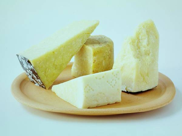 Dairy Art Print featuring the photograph A Variety Of Cheese On A Plate by Romulo Yanes