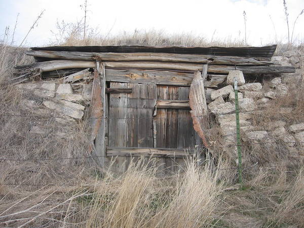 Hillside Doors And Entrance To Old Underground Dwelling. Art Print featuring the photograph Hillside Habitat by J W Kelly