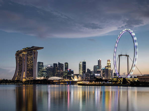 Built Structure Art Print featuring the photograph Singapore Skyline At Dusk by Martin Puddy