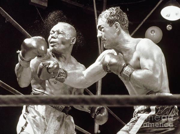 People Art Print featuring the photograph Rocky Marciano Defeats Jersey Joe by Bettmann