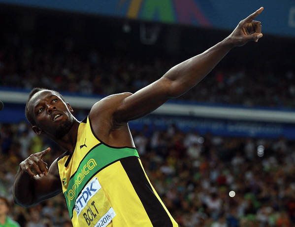 Usain Bolt 'to Di World' Pose Art Print featuring the photograph 13th Iaaf World Athletics Championships by Alexander Hassenstein