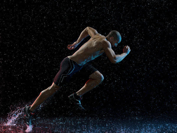 People Art Print featuring the photograph Athlete Runner Running Through Rain by Jonathan Knowles