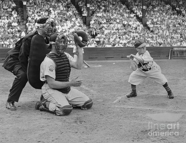Crowd Of People Art Print featuring the photograph Baseball Gimmick Utilizing Dwarf by Bettmann