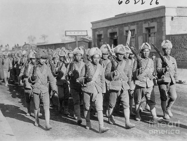 Marching Art Print featuring the photograph Chinese Soldiers Marching With Weapons by Bettmann