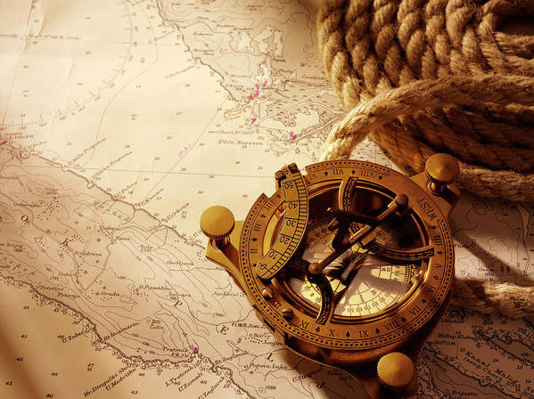Rope Art Print featuring the photograph Coiled Rope And Nautical Chart With A by Wragg