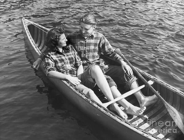 People Art Print featuring the photograph Couple Canoeing by Bettmann
