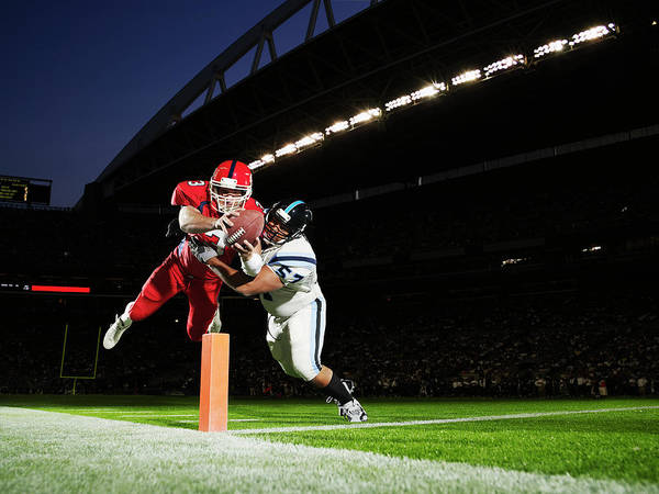 Sports Helmet Art Print featuring the photograph Football Player Diving Into End Zone by Thomas Barwick