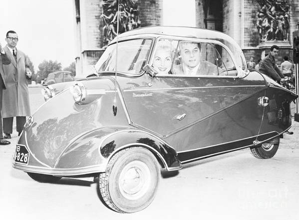 People Art Print featuring the photograph Janet Leigh And Tony Curtis In Minicar by Bettmann