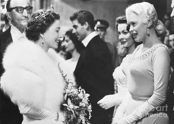 Royal Film Performance Art Print featuring the photograph Jayne Mansfield Meeting Queen Elizabeth by Bettmann