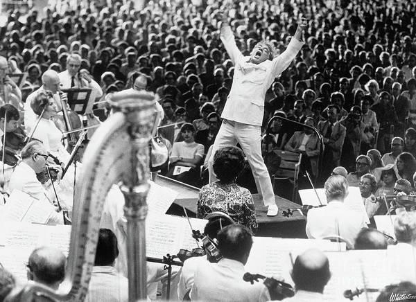 Crowd Of People Art Print featuring the photograph Leonard Bernstein Conducting Boston by Bettmann