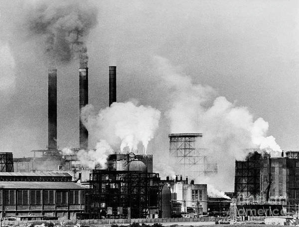 Air Pollution Art Print featuring the photograph Smoke Rising From Factory Smokestacks by Bettmann