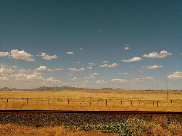 Tranquility Art Print featuring the photograph Texan Desert Landscape And Rail Tracks by Papilio