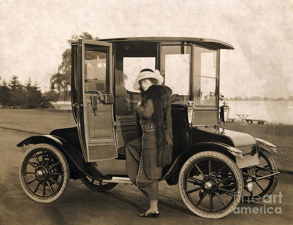 People Art Print featuring the photograph Woman And Electric Car by Bettmann