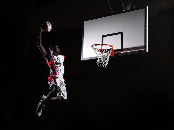 Human Arm Art Print featuring the photograph Young Man In The Air About To Dunk The by Compassionate Eye Foundation/steve Coleman/ojo Images Ltd