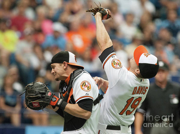 American League Baseball Art Print featuring the photograph Chris Davis and Caleb Joseph by Cliff Mcbride