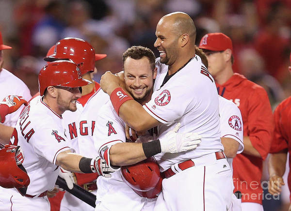 Ninth Inning Art Print featuring the photograph Johnny Giavotella, Albert Pujols, and Daniel Nava by Stephen Dunn