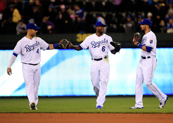 People Art Print featuring the photograph Lorenzo Cain, Alex Gordon, and Paulo Orlando by Jamie Squire
