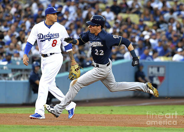 People Art Print featuring the photograph Manny Machado, Christian Yelich, and Lorenzo Cain by Jayne Kamin-oncea