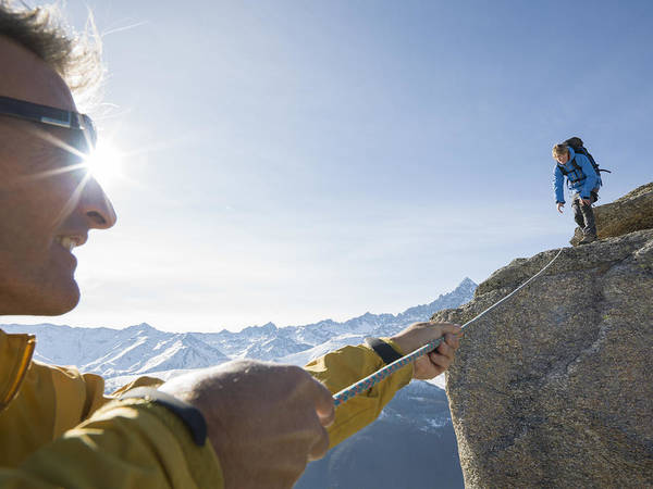 Young Men Art Print featuring the photograph Mountaineer pulls rope tight to teammate, mtns by Ascent Xmedia
