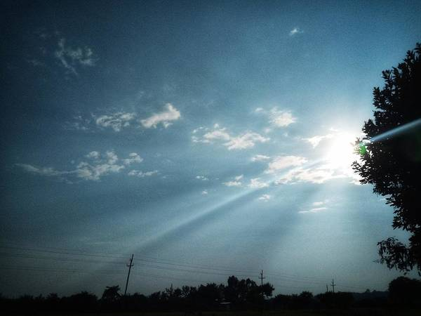 Sky Art Print featuring the photograph Striking rays by Yvonne's Ogolla