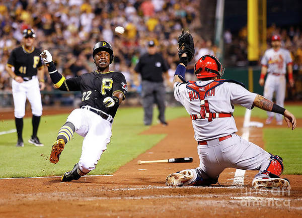 St. Louis Cardinals Art Print featuring the photograph Yadier Molina and Andrew Mccutchen by Jared Wickerham