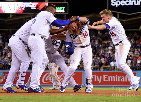 Ninth Inning Art Print featuring the photograph Yasiel Puig and Justin Turner by Harry How