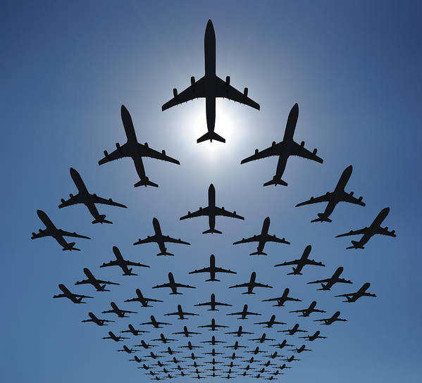 Expertise Art Print featuring the photograph Airplane Silhouettes Fly In V Formation by Georgo