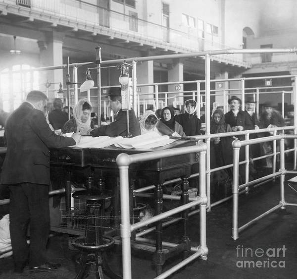 Crowd Of People Art Print featuring the photograph Immigrants Having Papers Checked by Bettmann
