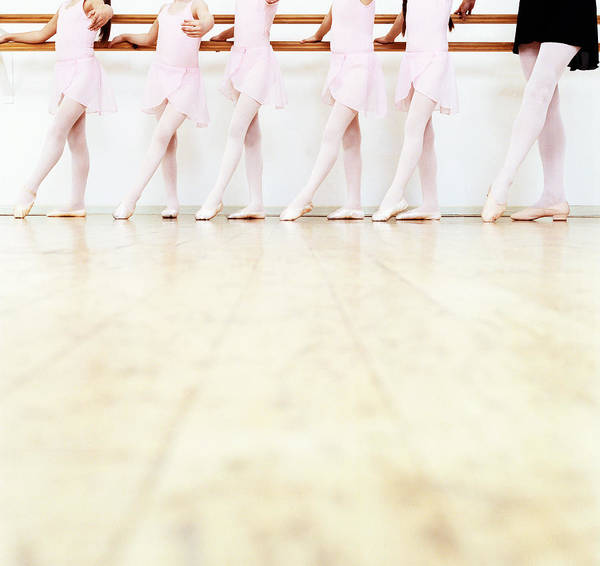 Ballet Dancer Art Print featuring the photograph Low Section View Of A Line Of Young by Digital Vision.