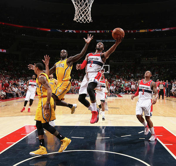 Playoffs Art Print featuring the photograph John Wall and Lance Stephenson by Ned Dishman