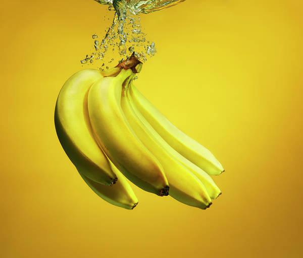 Copenhagen Art Print featuring the photograph Bananas Splashed Into Water by Henrik Sorensen