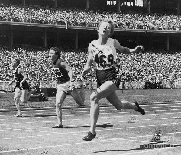 The Olympic Games Art Print featuring the photograph Hurdlers Racing To Finish Line by Bettmann