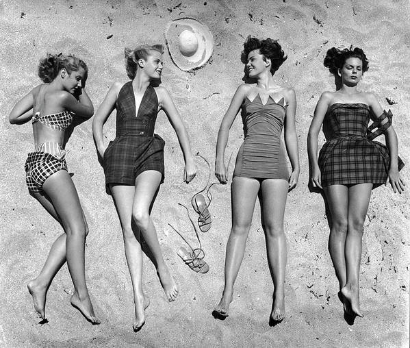 Timeincown Art Print featuring the photograph Models Lying On Beach To Display by Nina Leen