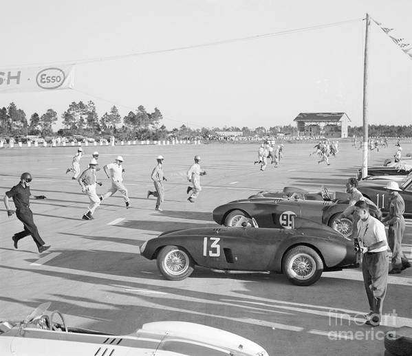 People Art Print featuring the photograph Racecar Drivers Running To Cars by Bettmann