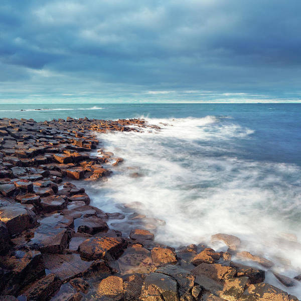 Water's Edge Art Print featuring the photograph Giants Causeway On A Cloudy Day by Mammuth
