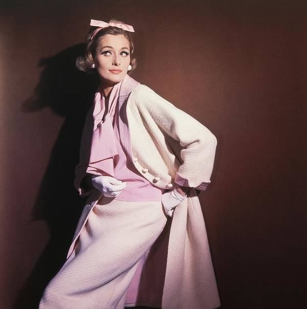 Studio Shot Art Print featuring the photograph Model Wearing White Coat Over Pink Blouse by Horst P. Horst