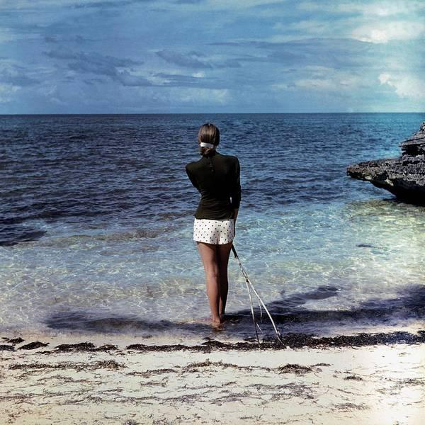 Fashion Art Print featuring the photograph A Woman On A Beach by Serge Balkin