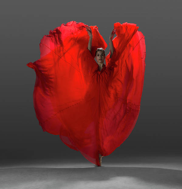 Ballet Dancer Art Print featuring the photograph Ballerina On Pointe With Red Dress by Nisian Hughes