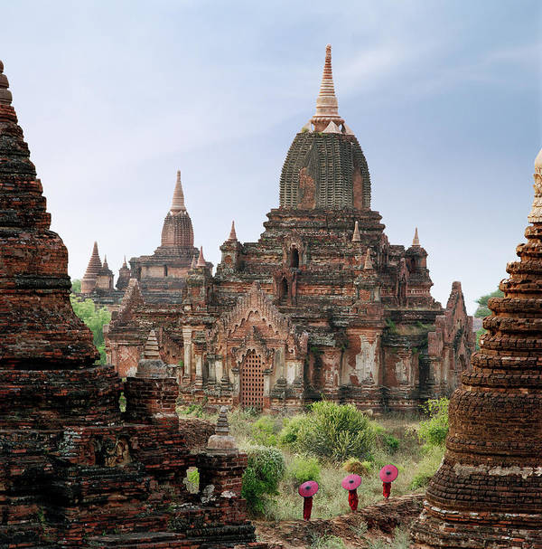 Tranquility Art Print featuring the photograph Buddhist Monks Walking Past Temple by Martin Puddy