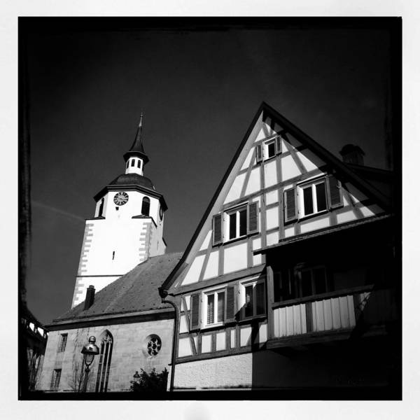 Church Art Print featuring the photograph Church and half-timbered house in lovely old town by Matthias Hauser