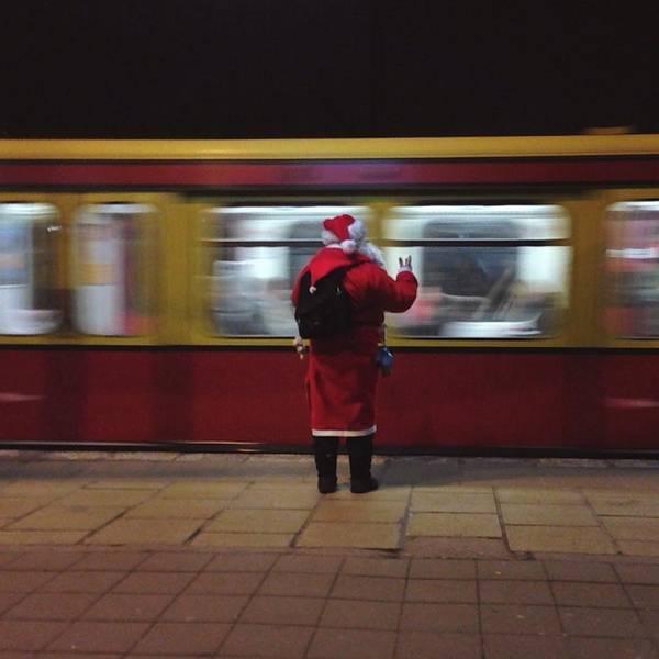 Passenger Train Art Print featuring the photograph Full Length Rear View Of Man In Santa by Monika Kanokova / Eyeem